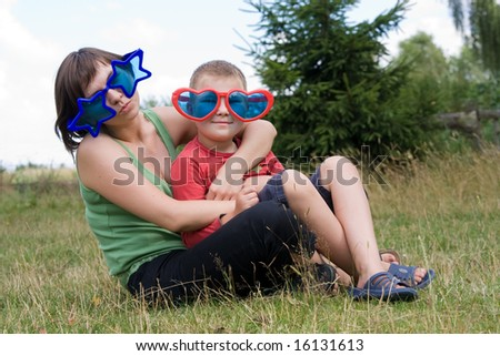 boy and his mother wearing funny glasses