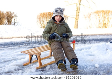 boy and his sled - stock photo