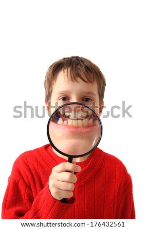 boy and magnify glass  - stock photo