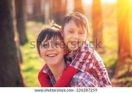 boy and mom have fun on park - stock photo