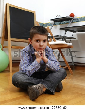 Boy and school obligations - stock photo