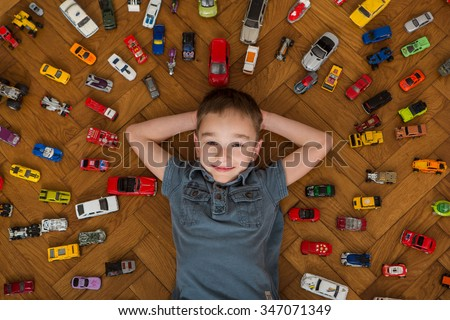 Boy and toy car - stock photo