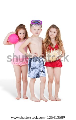Boy and two girls in beach suits, boy with swimming mask and girls with ball and seashell - stock photo
