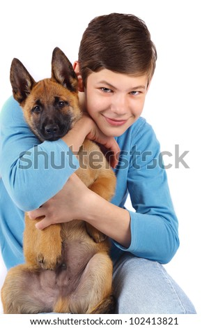 Boy and very young puppy belgian shepherd malinois isolated on whte