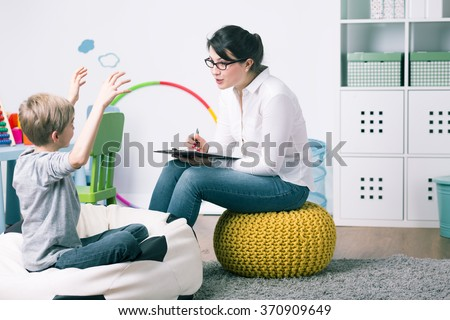 Boy and young woman teacher during private home lesson - stock photo