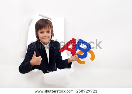 Boy approves the opening of back to school season - with copy space - stock photo