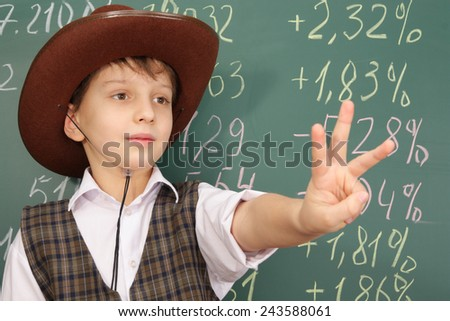 Boy as a trader in cowboy hat gesturing with hands