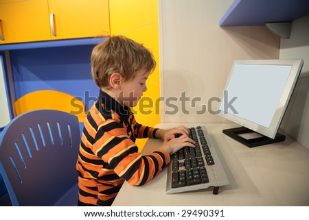 boy at computer in children's room - stock photo