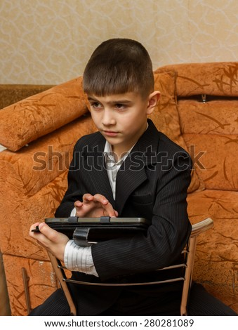 Boy at home with pc