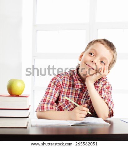 Boy at school. child in the classroom - stock photo