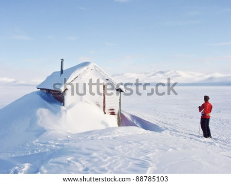 Boy at ski resting at a hunting lodge in the norwegian mountains at winter time - stock photo