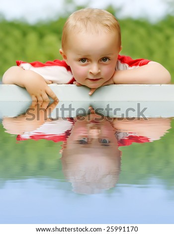 Boy at the Edge of a Swimming Pool - stock photo