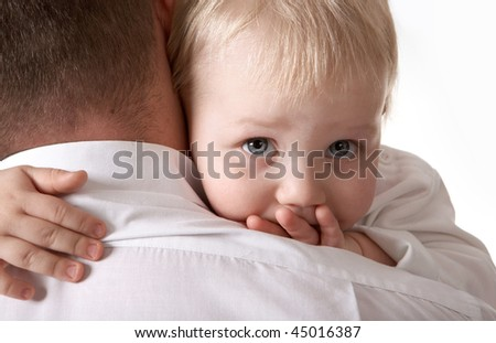Boy at the hands of his father.