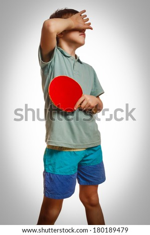 Boy athlete upset defeat table tennis ping pong covered his face isolated on white background gray
