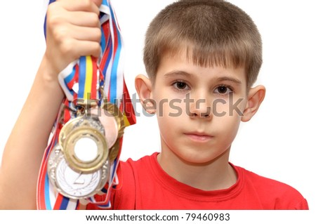 Boy-athlete with medals. Isolated on white background. - stock photo