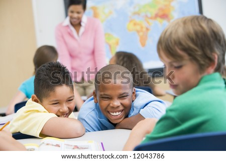 Boy being bullied in elementary school class - stock photo