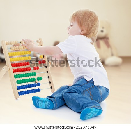 boy believes in the accounts of the Montessori classroom.the concept of a happy childhood, education of children, teens - stock photo