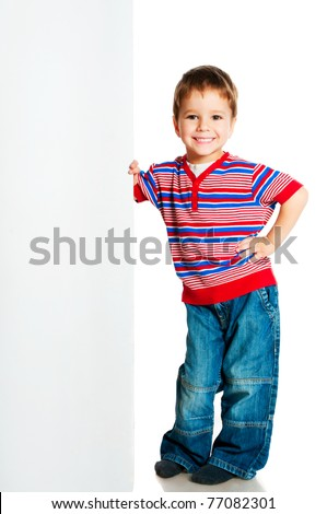 boy beside a white blank for text or image - stock photo