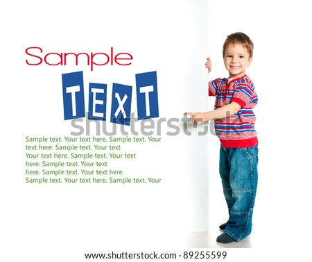 boy beside a white blank with sample text - stock photo