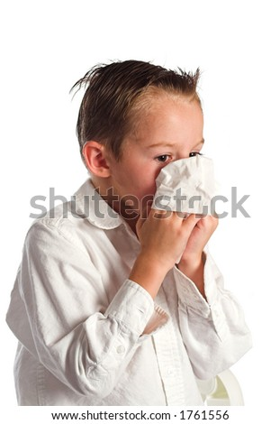 Boy blowing nose - stock photo
