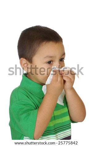 boy blowing nose, three years old, isolated on white