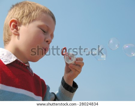 boy blowing soap bubble - stock photo