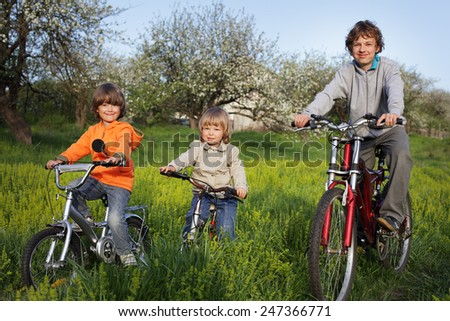 boy brothers ride bikes - stock photo