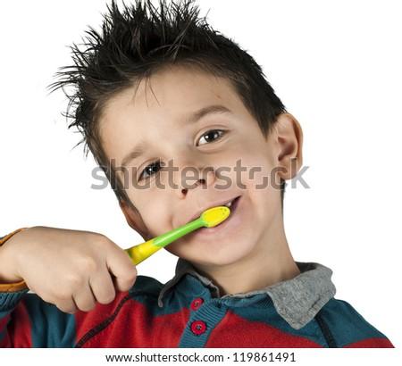 Boy brushing his teeth. White isolated - stock photo