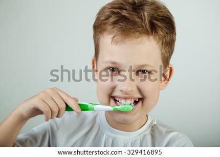 boy brushing teeth - stock photo