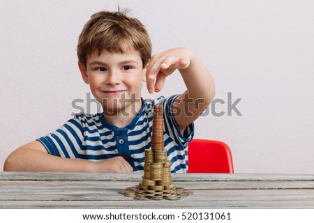 Boy building stack of money. Financial safety, investment building concept.