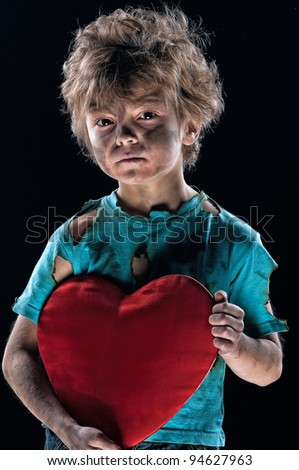 Boy burnt of love with heart over white background - stock photo