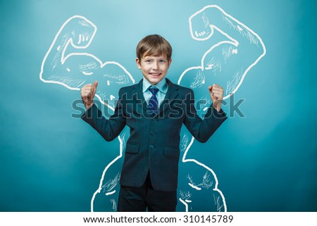 boy businessman teen shows biceps muscles of the back background studio success victory - stock photo