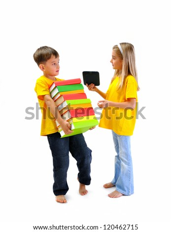 Boy carrying heavy books, girl shows him an e-book - stock photo