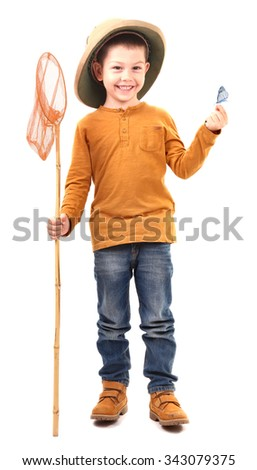 Boy caught an butterfly and and holding it proudly - stock photo