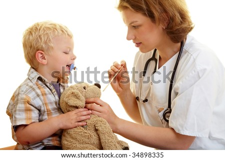 Boy checks his stuffed animal at the pediatrist - stock photo