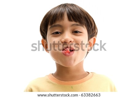 Boy chewing gum with open mouth - stock photo