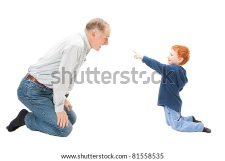 Boy child having fun with his grandfather. Isolated on white.