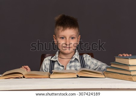 Boy Child Read Book, Children Education, Well Dressed Schoolboy on Gray background