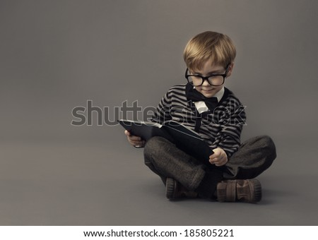 Boy Child Read Book, Clever Kid in Glasses Study, Children Education, Well Dressed Schoolboy on Gray background - stock photo