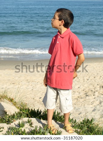 Boy child with modern summer clothes at the beach