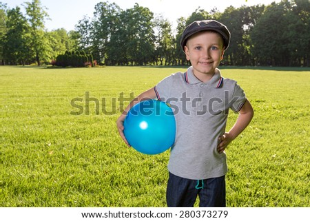 Boy children playing ball outdoor in the park - stock photo