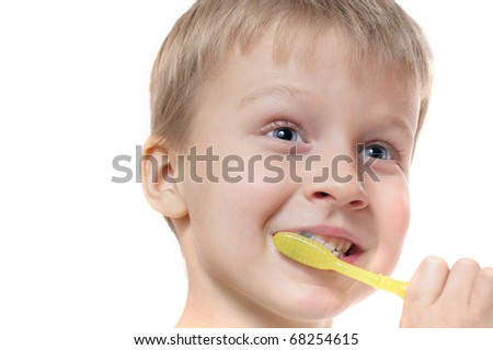 boy cleaning his teeth over white background - stock photo