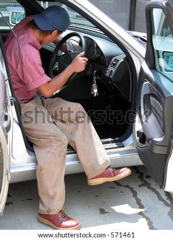 Boy cleaning the car interior