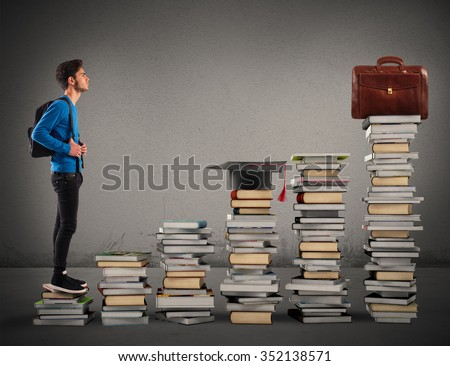 Boy climbing the stairs made of books - stock photo