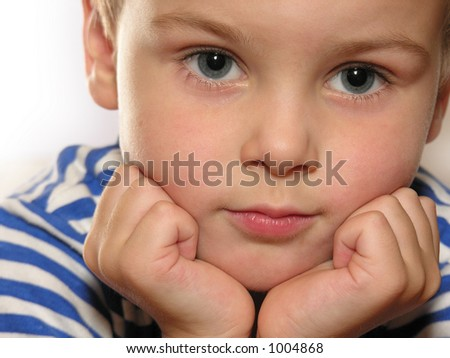 boy closeup with hands