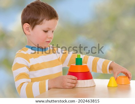 Boy collects piece.passionate child for interesting occupation,active lifestyle,happiness concept,carefree childhood concept. - stock photo