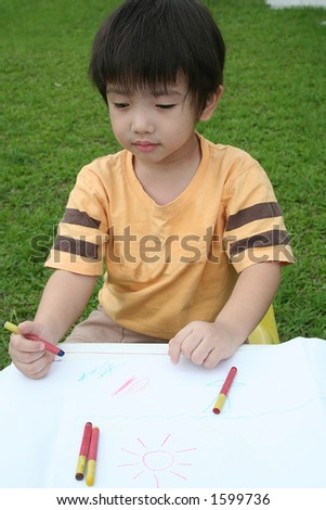 Boy coloring with crayon - stock photo