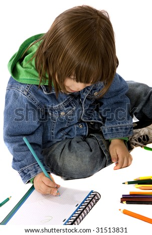 boy colouring on a notebook isolated over a white background - stock photo
