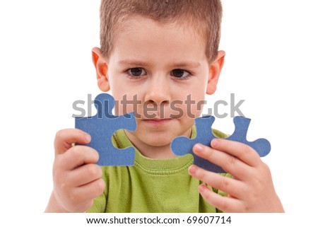 Boy connect puzzles isolated on white - stock photo