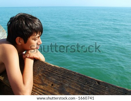 Boy Contemplating the Sea - stock photo